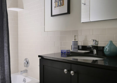 Updated bathroom with large shower and tiled walls in Radwyn apartments