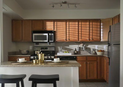 Spacious kitchen with wooden cabinets and breakfast bar in Bryn Mawr apartment