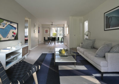 Furnished spacious and open floor plan with living room and dining room in Radwyn apartment