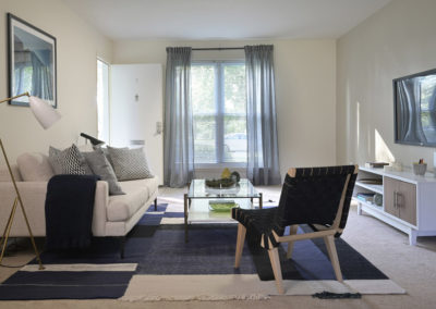 Furnished living room with large windows in Bryn Mawr apartment for rent