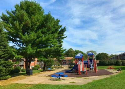 Child-friendly playground with spacious field for residents on Radwyn apartment grounds in Bryn Mawr, PA